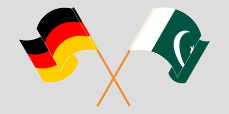 Crossed and waving flags of Pakistan and Germany