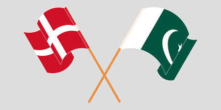 Crossed and waving flags of Pakistan and Denmark 向量圖像