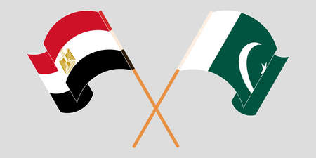 Crossed and waving flags of Pakistan and Egypt