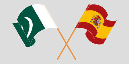 Crossed and waving flags of Pakistan and Spain