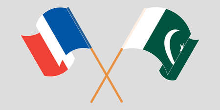 Crossed and waving flags of Pakistan and France