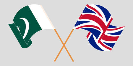 Crossed and waving flags of Pakistan and the UK 向量圖像