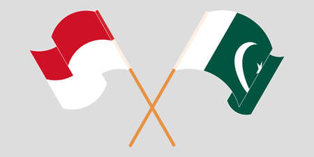 Crossed and waving flags of Pakistan and Indonesia