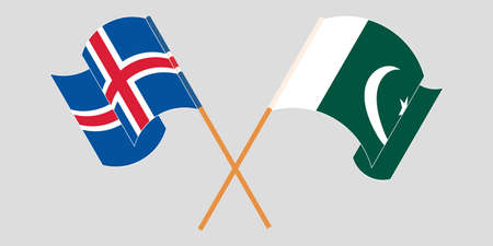 Crossed and waving flags of Pakistan and Iceland