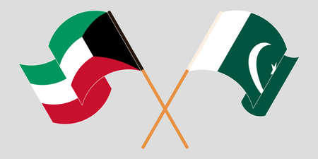 Crossed and waving flags of Pakistan and Kuwait