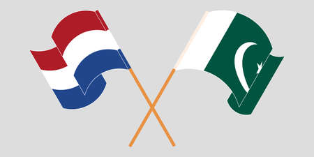 Crossed and waving flags of Pakistan and the Netherlands