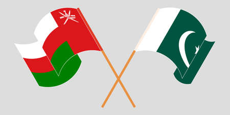 Crossed and waving flags of Pakistan and Oman