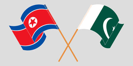 Crossed and waving flags of Pakistan and North Korea