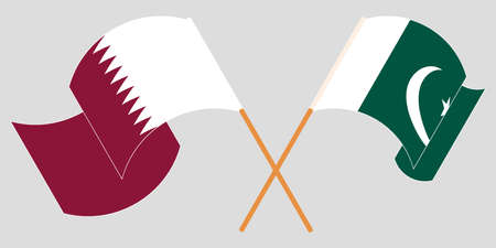 Crossed and waving flags of Pakistan and Qatar