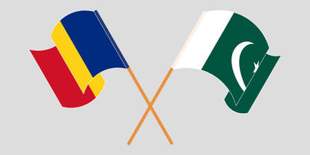 Crossed and waving flags of Pakistan and Romania