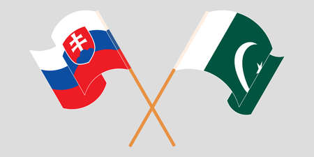 Crossed and waving flags of Pakistan and Slovakia