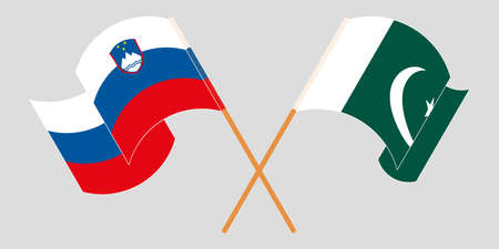 Crossed and waving flags of Pakistan and Slovenia