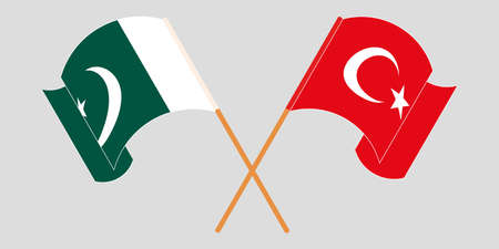 Crossed and waving flags of Pakistan and Turkey