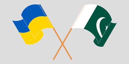 Crossed and waving flags of Pakistan and the Ukraine