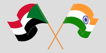 Crossed and waving flags of Sudan and India