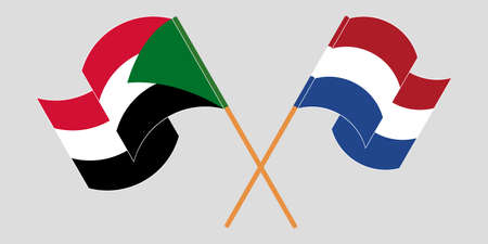 Crossed and waving flags of Sudan and the Netherlands