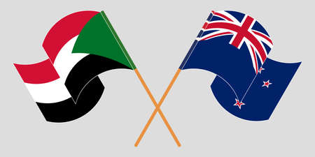 Crossed and waving flags of Sudan and New Zealand