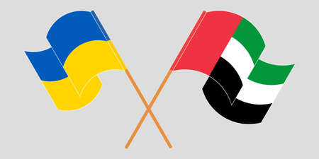 Crossed and waving flags of the Ukraine and the United Arab Emirates 向量圖像