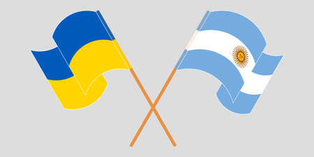 Crossed and waving flags of the Ukraine and Argentina 向量圖像