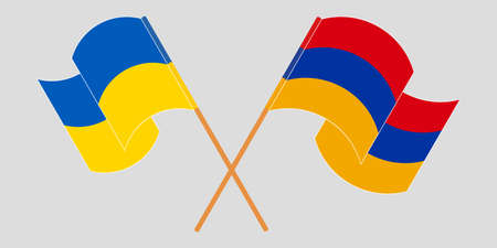 Crossed and waving flags of the Ukraine and Armenia