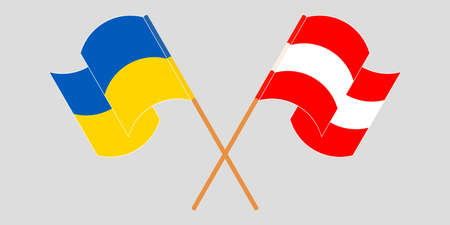 Crossed and waving flags of the Ukraine and Austria