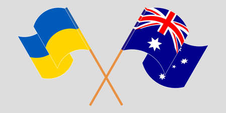 Crossed and waving flags of the Ukraine and Australia