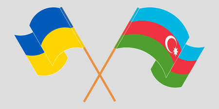 Crossed and waving flags of the Ukraine and Azerbaijan