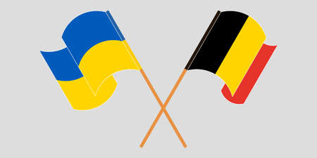 Crossed and waving flags of the Ukraine and Belgium