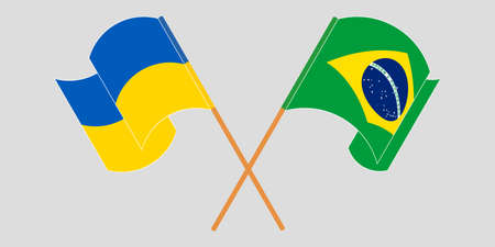 Crossed and waving flags of the Ukraine and Brazil