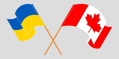 Crossed and waving flags of the Ukraine and Canada 向量圖像