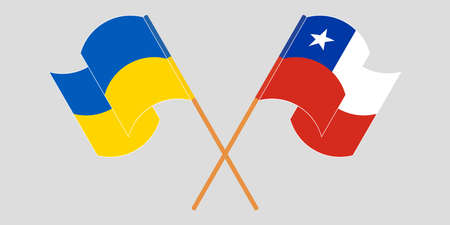 Crossed and waving flags of the Ukraine and Chile