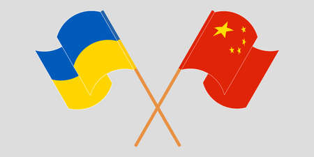 Crossed and waving flags of the Ukraine and China