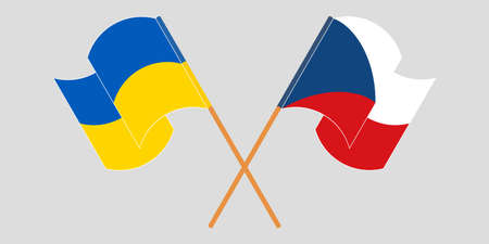 Crossed and waving flags of the Ukraine and Czech Republic