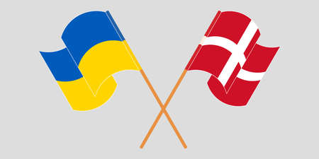 Crossed and waving flags of the Ukraine and Denmark
