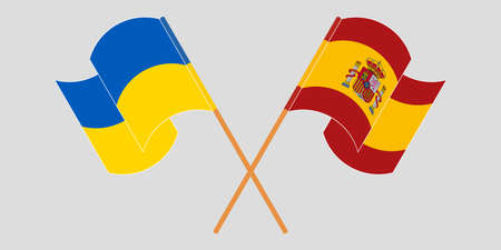 Crossed and waving flags of the Ukraine and Spain 向量圖像