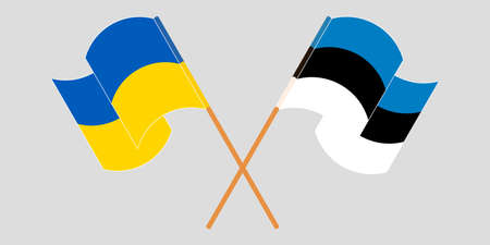 Crossed and waving flags of the Ukraine and Estonia