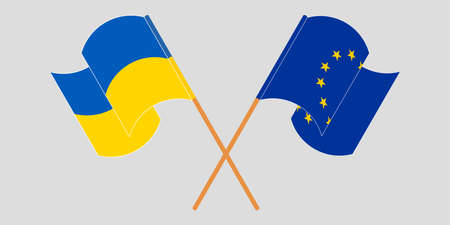 Crossed and waving flags of the Ukraine and the EU