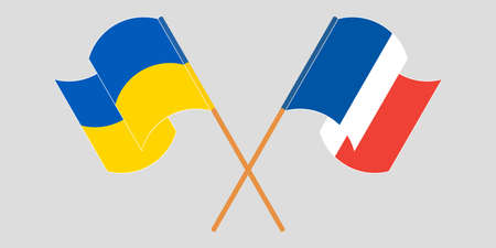 Crossed and waving flags of Ukraine and France
