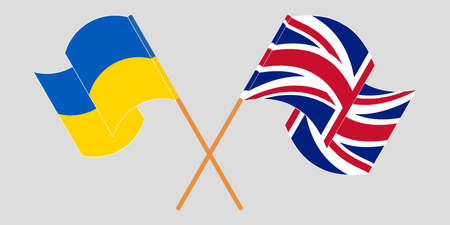 Crossed and waving flags of the Ukraine and the UK