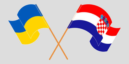 Crossed and waving flags of the Ukraine and Croatia