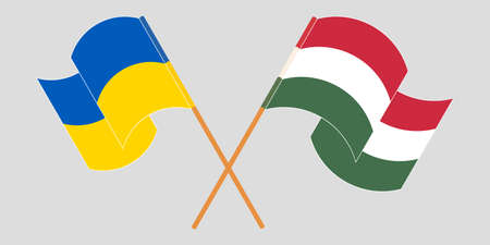 Crossed and waving flags of Ukraine and Hungary 向量圖像