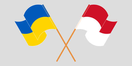 Crossed and waving flags of the Ukraine and Indonesia