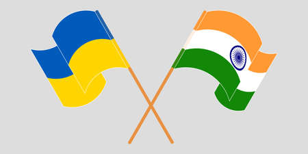 Crossed and waving flags of the Ukraine and India 向量圖像