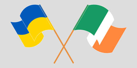 Crossed and waving flags of the Ukraine and Ireland