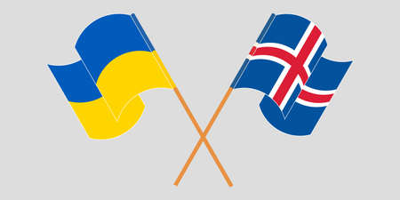 Crossed and waving flags of the Ukraine and Iceland 向量圖像