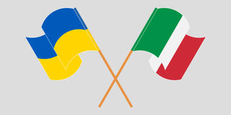 Crossed and waving flags of the Ukraine and Italy