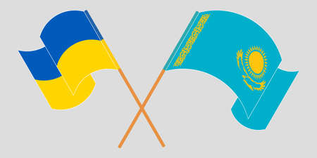 Crossed and waving flags of the Ukraine and Kazakhstan 向量圖像