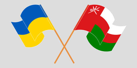 Crossed and waving flags of Ukraine and Oman