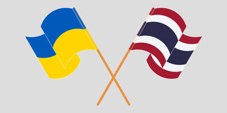 Crossed and waving flags of Ukraine and Thailand 向量圖像