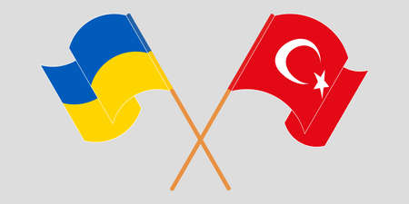 Crossed and waving flags of the Ukraine and Turkey